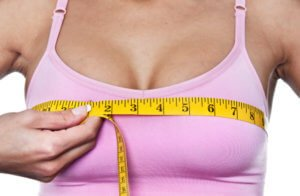 woman checking size of her breast after enlargement