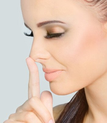 a woman touching her nose