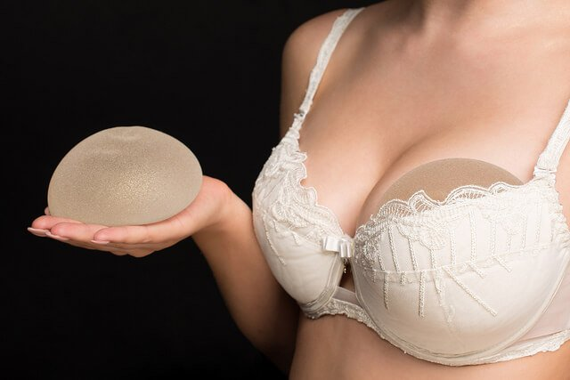 girl in bra with breast implants