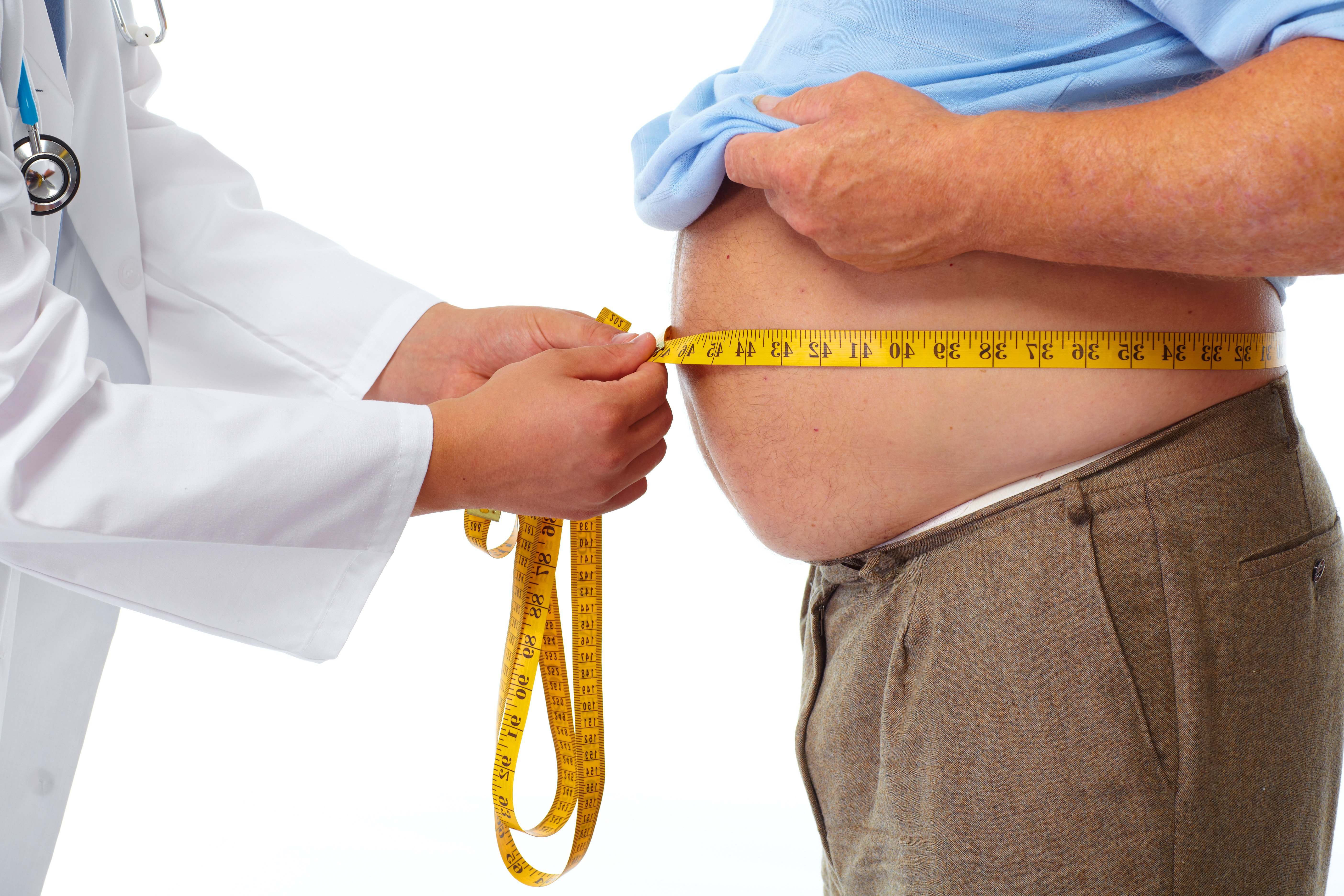 fat belly is measured by the doctor with measuring tape